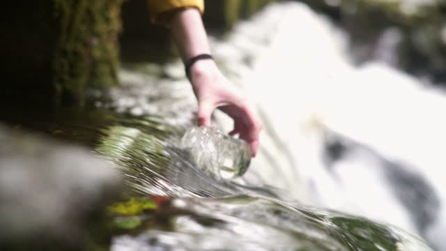 girl explorer collecting water sample in a beaker for stem research - environmentalist stock videos & royalty-free footage