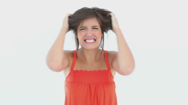 stockvideo's en b-roll-footage met girl expressing her anger - tanden op elkaar klemmen