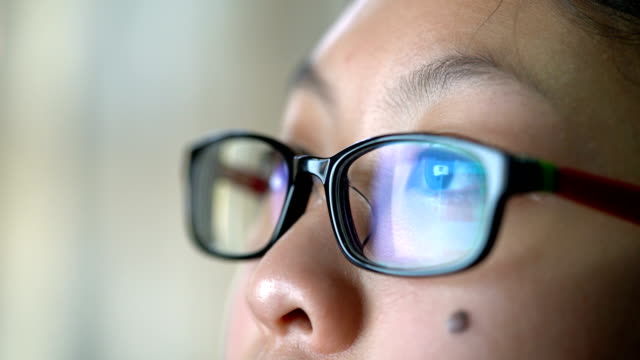 girl eye with eyeglasses looking computer monitor, surfing internet or social media - eyeglasses stock videos & royalty-free footage