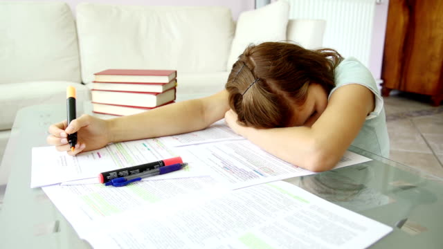 girl falling asleep because of too much studying - pen stock videos & royalty-free footage