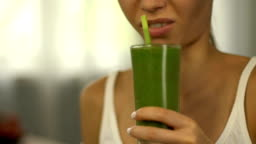 Girl feels disgust to smoothie for weight loss, healthy but tasteless nutrition