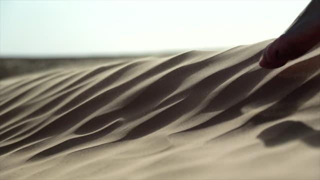 Girl feet in the sand