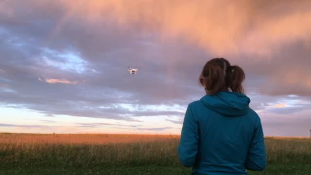 girl flying drone uav - haarzopf stock-videos und b-roll-filmmaterial