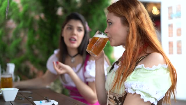 girl friends drinking a beer - portrait - traditional clothing stock videos & royalty-free footage