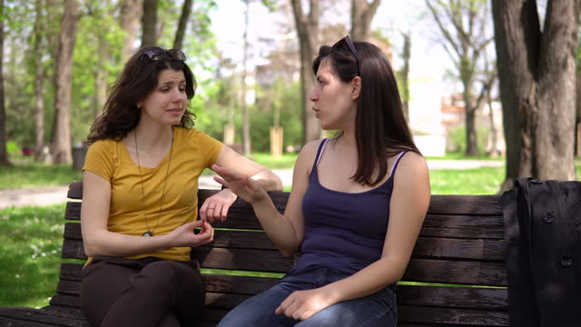 girl friends talking in park - bench stock videos & royalty-free footage