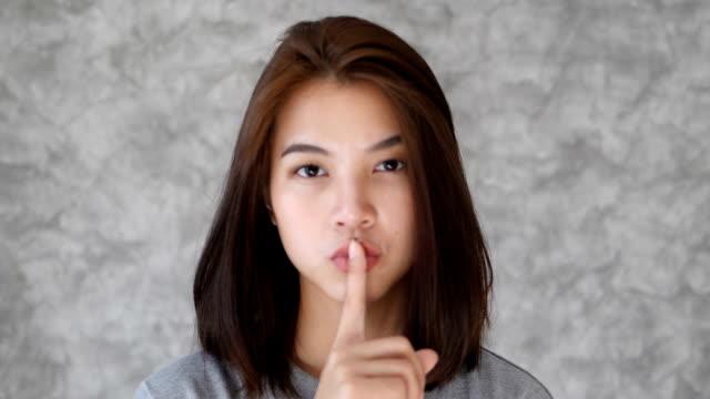 girl gesture silence sign - silenzio video stock e b–roll