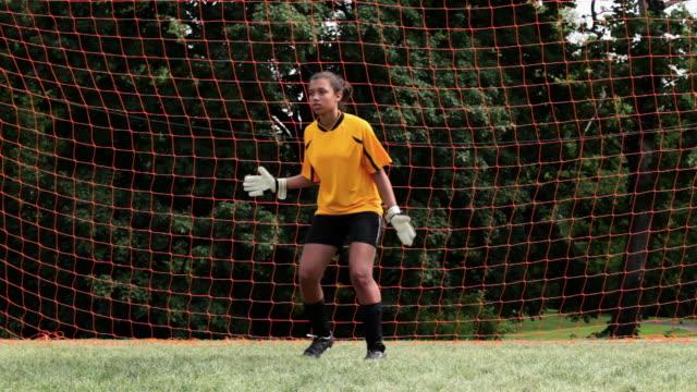 Girl goalkeeper making a save