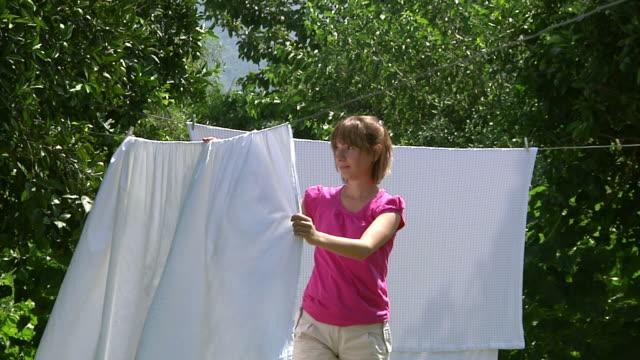Girl Hanging Laundry
