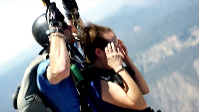 Girl Hangs On During Parachute Opening