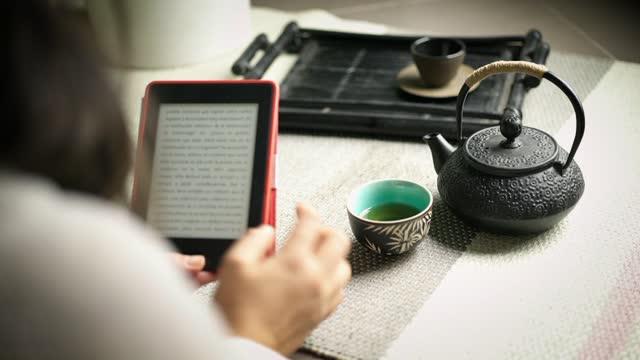 girl having a tea - e reader stock videos & royalty-free footage