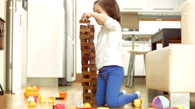 girl having fun stacking blocks - toy block stock videos and b-roll footage