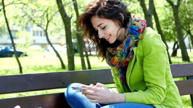 Girl having fun with cell phone