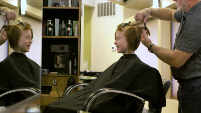 girl having her hair cut by a hairdresser - wet hair stock videos & royalty-free footage