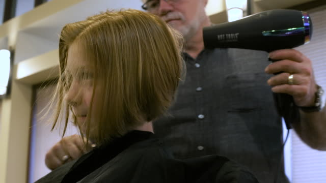 girl having her hair dried by a hairdresser - drying stock videos and b-roll footage