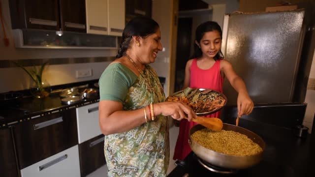 girl helping her grandmother in roasting spices - cute stock videos & royalty-free footage