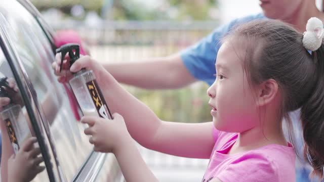 girl helping her mother wash the car - hot pink stock videos & royalty-free footage