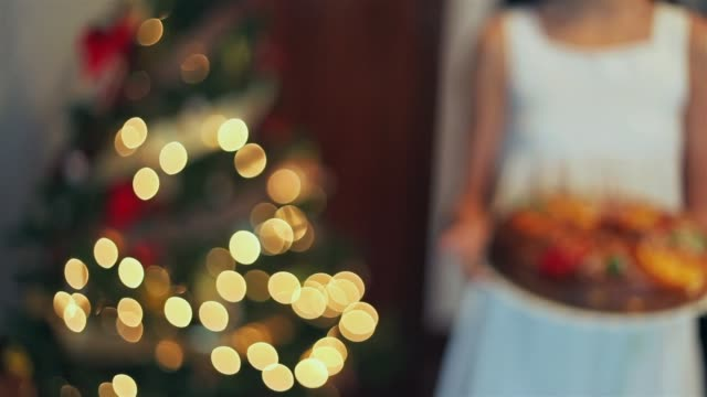 girl holding a typical spanish christmas sweet. roscón de reyes. - parte de una serie video stock e b–roll