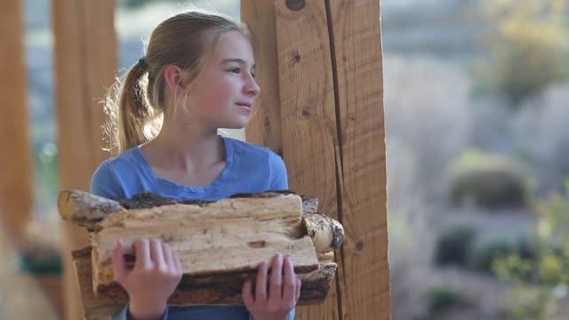 girl holding firewood