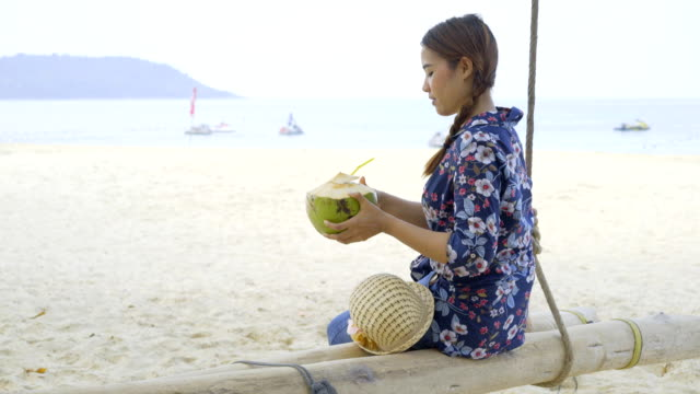Girl Holding Fresh Cold Coconut At Tropical Beach