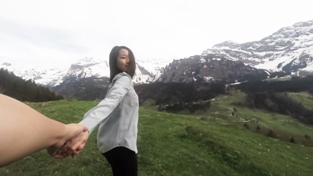 SLO Girl holding hands with boy and runing on the top of Mountain