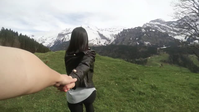 slo girl holding hands with boy and runing on the top of mountain - leather jacket stock videos and b-roll footage