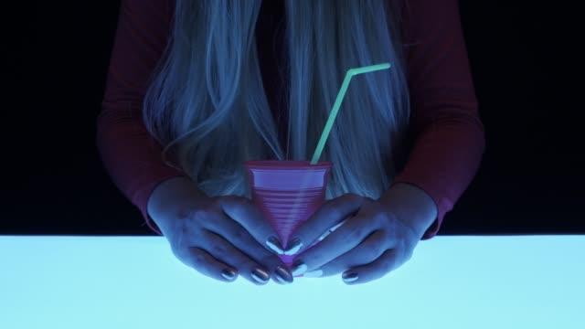 girl holding plastic glass. futuristic mood - straw stock videos & royalty-free footage