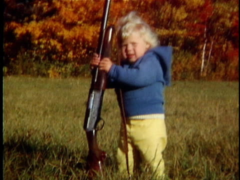 stockvideo's en b-roll-footage met 1963 ms tu girl (2-3) holding shot gun in field, vermont, usa - 2 3 jaar