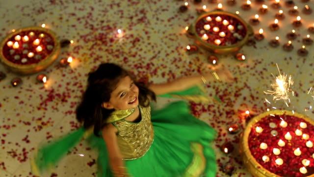 ms ha girl holding sparklers and spinning while enjoying diwali festival - rose petal stock videos and b-roll footage