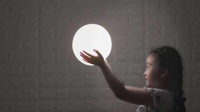 girl holding the moon at night - individuality stock videos & royalty-free footage