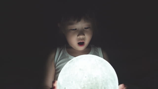 girl holding the moon - bedroom stock videos & royalty-free footage