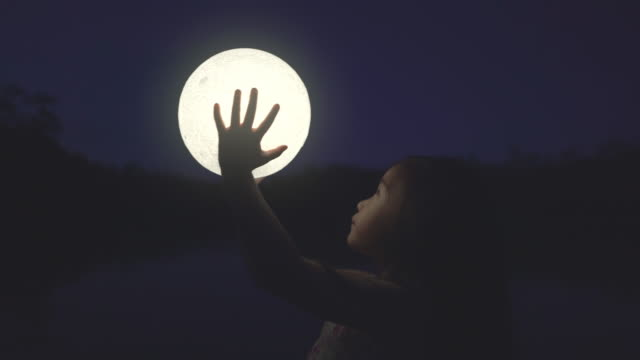 girl holding the moon - copy space stock videos & royalty-free footage
