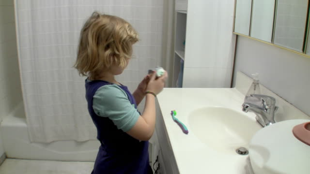 ms girl (6-7) holding toothpaste / brooklyn, new york, usa - household fixture stock videos and b-roll footage