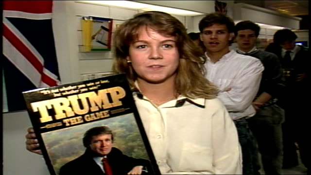 girl holding trump the game saying it will be a hit because everything he touches turns to gold - 1989 stock videos & royalty-free footage