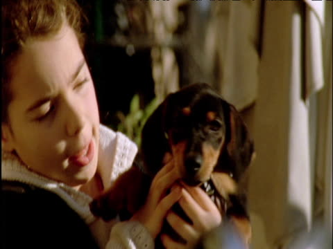 girl holds puppy outside cafŽ rome - girls videos stock videos & royalty-free footage