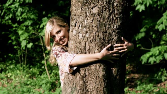Girl hugs tree
