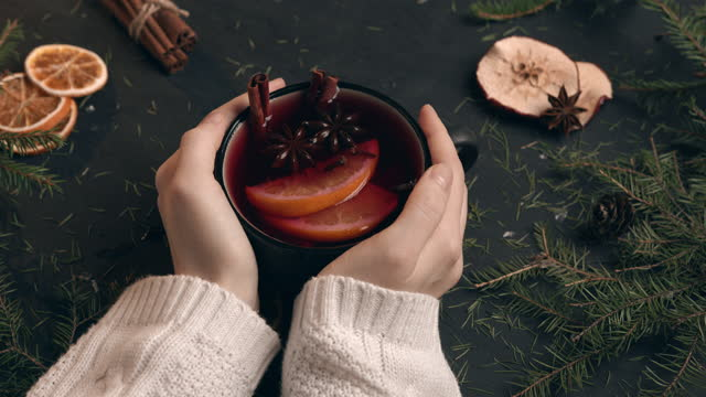 a girl in a soft knitted sweater holds a cup of mulled wine with both hands - scented stock videos & royalty-free footage