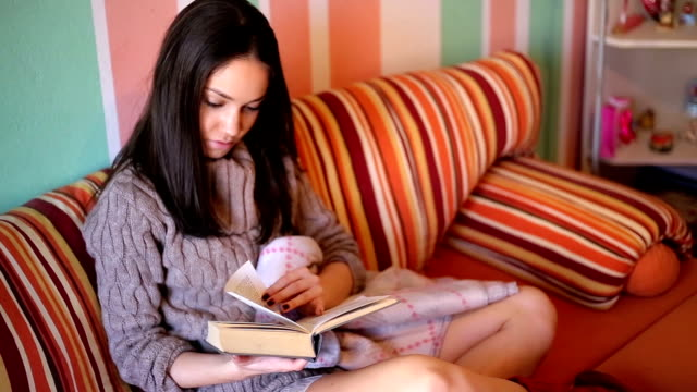 girl in bed  reading a book - leg warmers stock videos & royalty-free footage