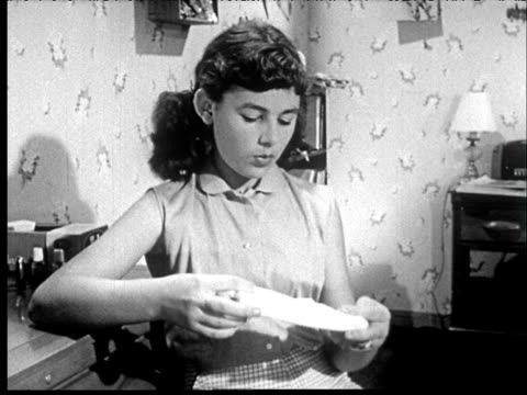 1953 b/w girl in bedroom pulls tampon out of drawer, talks to sister - menstruation stock videos & royalty-free footage