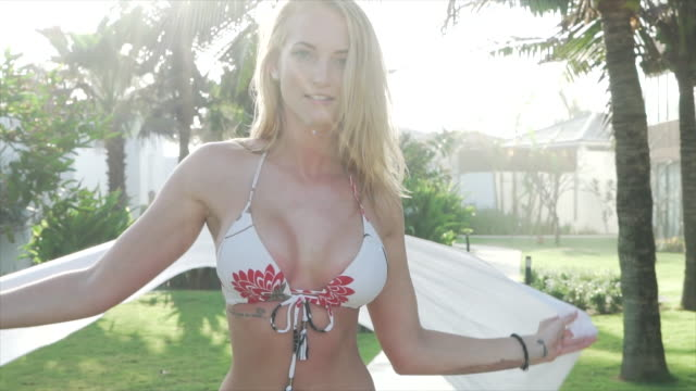 girl in biking posing in garden - sarong stock videos and b-roll footage