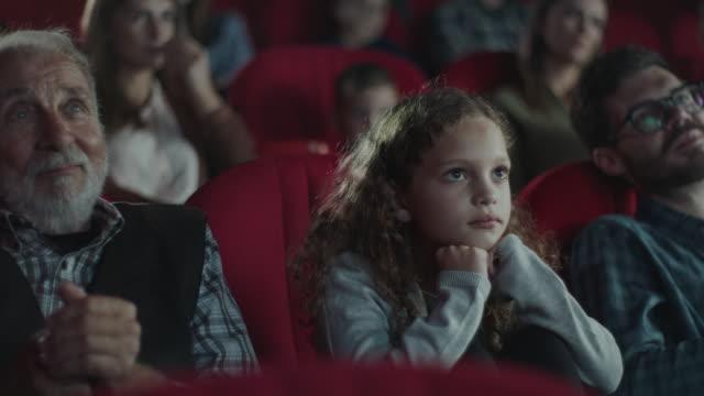 girl in cinema - film premiere stock videos & royalty-free footage