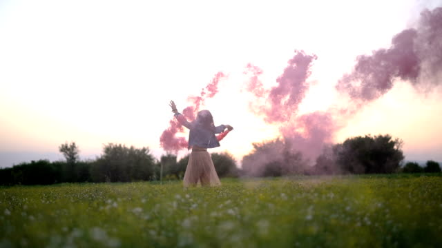 girl in denim jacket and a dress holding a red smoke - denim jacket stock videos and b-roll footage