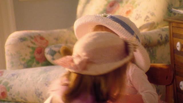 ms girl in hat playing dress-up putting hat + necklace on girl toddler - vid bildbanksvideor och videomaterial från bakom kulisserna