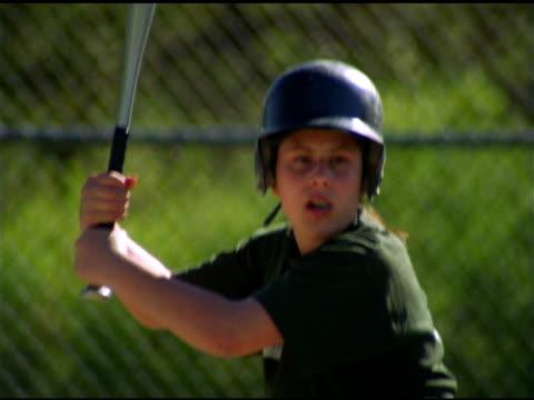 Girl in helmet swings baseball bat, Pawtucket