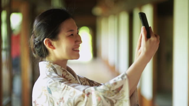 girl in kimono taking selfie - photographing self stock videos & royalty-free footage
