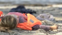 Girl in life vest lying on coast without consciousness, natural disaster victim