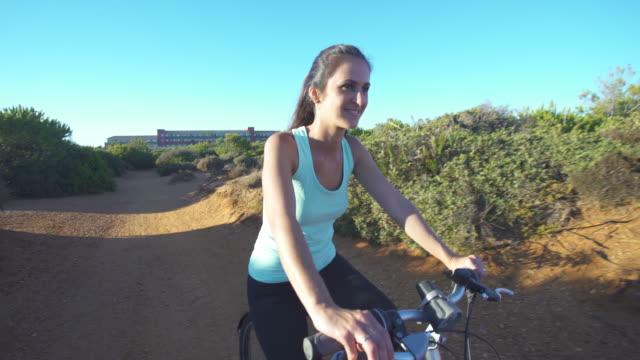 Girl in mountain bike near to the sea