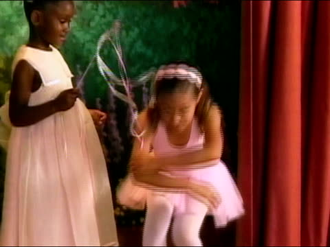 girl in pink tutu and girl in fairy costume performing on stage during ballet recital / curtseying / los angeles, california - tutu stock videos & royalty-free footage