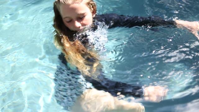 girl in pool - wet hair stock videos & royalty-free footage