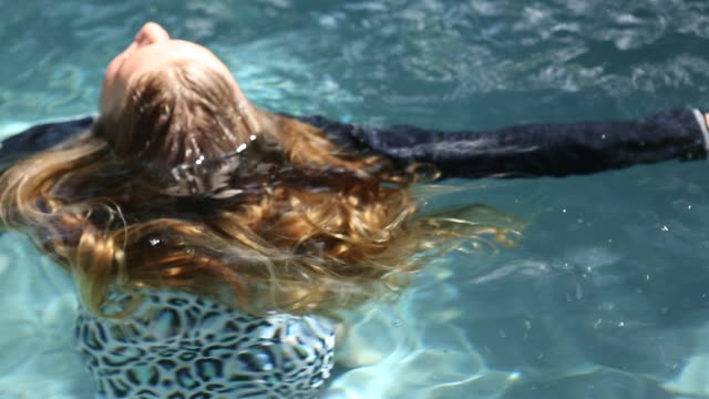 girl in pool - wet hair stock videos and b-roll footage