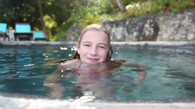 girl in pool - 10 11 years stock videos and b-roll footage